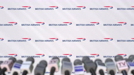 press wall : BRITISH AIRWAYS company press conference, press wall with logo and mics, conceptual editorial animation Stock Footage