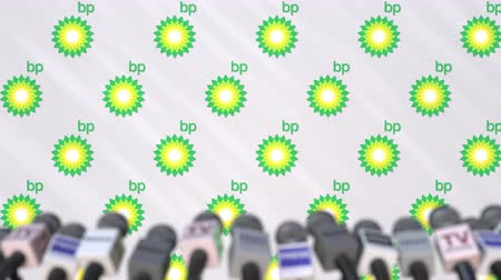 press wall : News conference of BP, press wall with logo as a background and mics, editorial animation Stock Footage