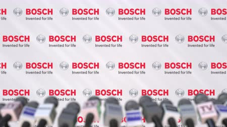 press wall : News conference of BOSCH, press wall with logo as a background and mics, editorial animation Stock Footage