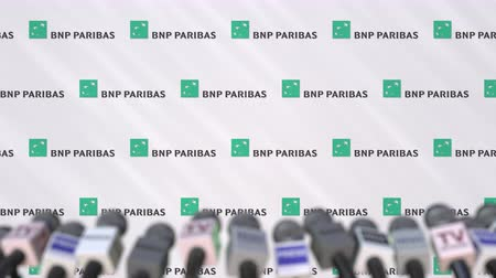 declaring : Press conference of BNP PARIBAS, press wall with logo and microphones, conceptual editorial animation