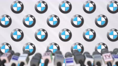 loga : Press conference of BMW, press wall with logo and microphones, conceptual editorial animation