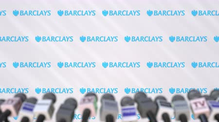 duyuru : Media event of BARCLAYS, press wall with logo and microphones, editorial animation Stok Video