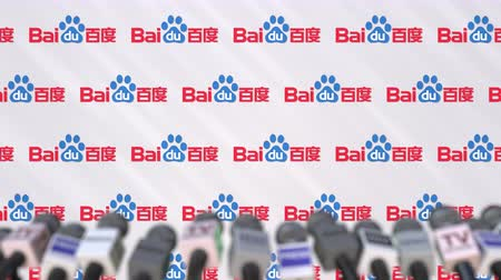 declaring : Media event of BAIDU, press wall with logo and microphones, editorial animation Stock Footage