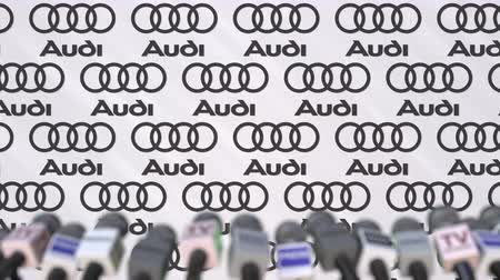 declaring : Media event of AUDI, press wall with logo and microphones, editorial animation Stock Footage