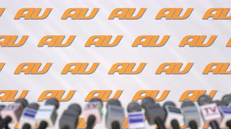 declaring : News conference of AU, press wall with logo as a background and mics, editorial animation