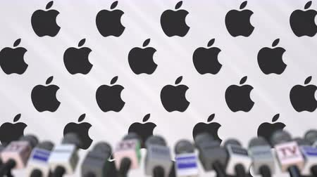 declaring : Press conference of APPLE, press wall with logo and microphones, conceptual editorial animation Stock Footage