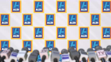 declaring : News conference of ALDI, press wall with logo as a background and mics, editorial animation