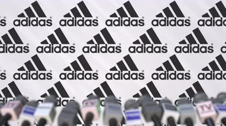 press wall : Media event of ADIDAS, press wall with logo and microphones, editorial animation