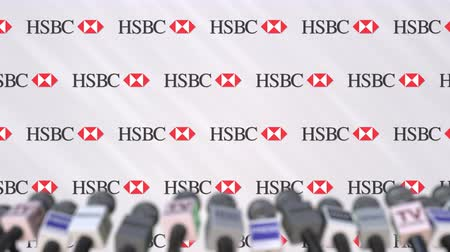 declaring : Media event of HSBC, press wall with logo and microphones, editorial animation