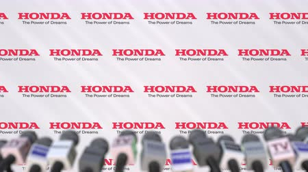 duyuru : HONDA company press conference, press wall with logo and mics, conceptual editorial animation