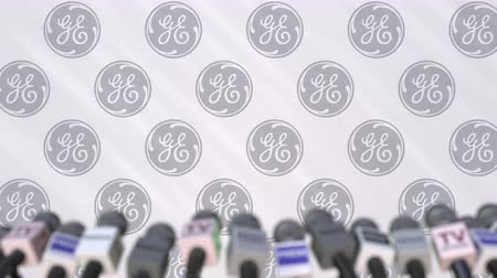 general electric : Press conference of GENERAL ELECTRIC, press wall with logo and microphones, conceptual editorial animation