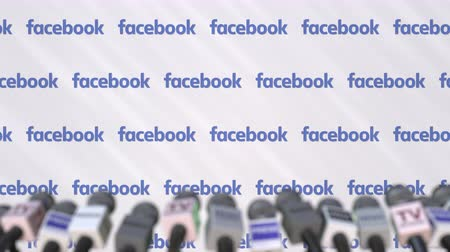 duyuru : News conference of FACEBOOK, press wall with logo as a background and mics, editorial animation