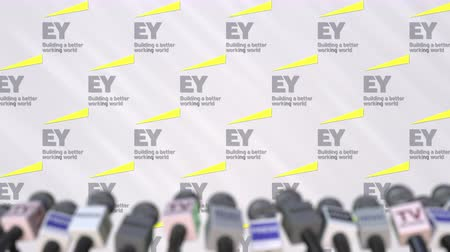 утверждение : Press conference of EY, press wall with logo and microphones, conceptual editorial animation Стоковые видеозаписи