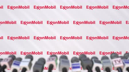 duyuru : Media event of EXXON MOBIL, press wall with logo and microphones, editorial animation Stok Video