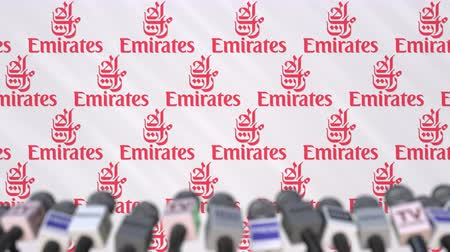 declaring : EMIRATES AIRLINES company press conference, press wall with logo and mics, conceptual editorial animation Stock Footage