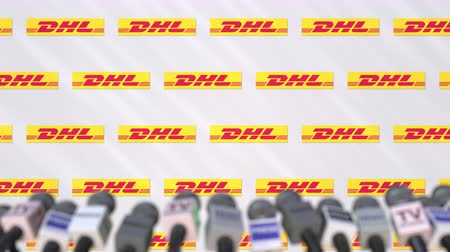 declaring : Press conference of DHL, press wall with logo and microphones, conceptual editorial animation Stock Footage