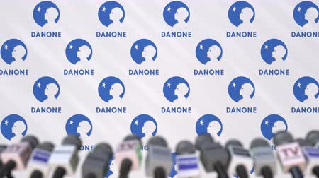 press conference : Media event of DANONE, press wall with logo and microphones, editorial animation
