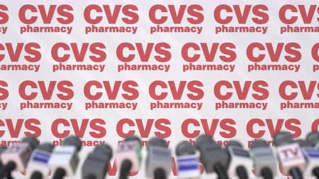 declaring : CVS PHARMACY company press conference, press wall with logo and mics, conceptual editorial animation Stock Footage
