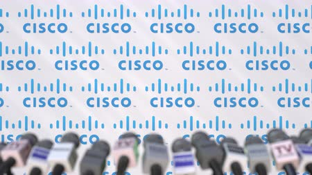press wall : Media event of CISCO, press wall with logo and microphones, editorial animation Stock Footage