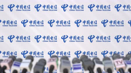 утверждение : Media event of CHINA TELECOM, press wall with logo and microphones, editorial animation Стоковые видеозаписи