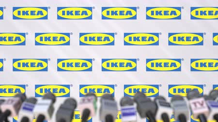 dekking : IKEA company press conference, press wall with logo and mics, conceptual editorial animation
