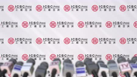 declaring : News conference of ICBC, press wall with logo as a background and mics, editorial animation Stock Footage