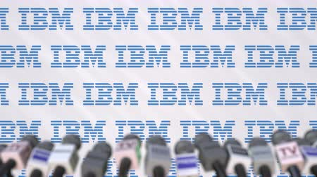 duyuru : Media event of IBM, press wall with logo and microphones, editorial animation