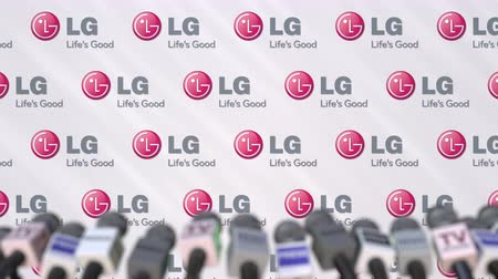 declaring : Media event of LG, press wall with logo and microphones, editorial animation Stock Footage