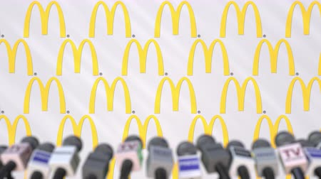 press conference : Media event of MCDONALDS, press wall with logo and microphones, editorial animation