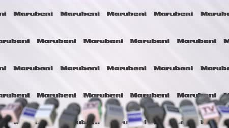 declaring : MARUBENI company press conference, press wall with logo and mics, conceptual editorial animation