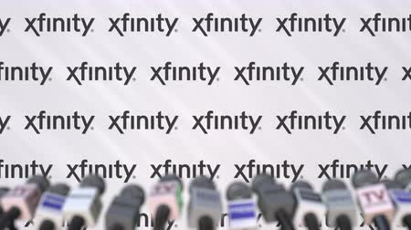 press wall : XFINITY company press conference, press wall with logo and mics, conceptual editorial animation Stock Footage