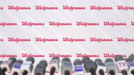 declaring : News conference of WALGREENS, press wall with logo as a background and mics, editorial animation