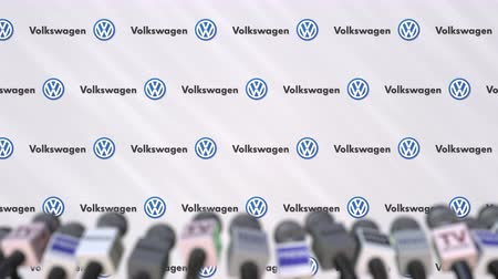 press wall : VOLKSWAGEN company press conference, press wall with logo and mics, conceptual editorial animation