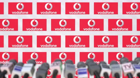 declaring : VODAFONE company press conference, press wall with logo and mics, conceptual editorial animation