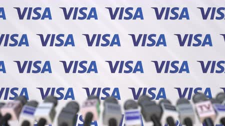 declaring : Media event of VISA, press wall with logo and microphones, editorial animation Stock Footage