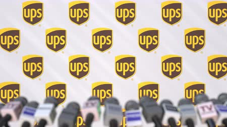 declaring : UPS company press conference, press wall with logo and mics, conceptual editorial animation Stock Footage