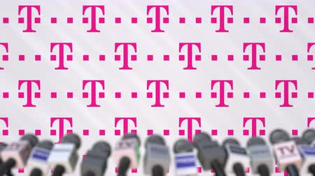 press conference : Media event of T TELEKOM, press wall with logo and microphones, editorial animation Stock Footage