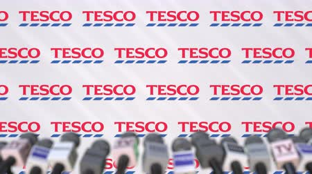 press wall : Press conference of TESCO, press wall with logo and microphones, conceptual editorial animation Stock Footage