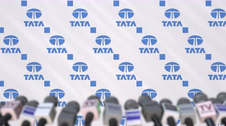 press conference : TATA company press conference, press wall with logo and mics, conceptual editorial animation