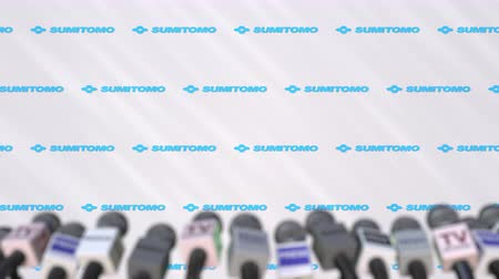 press wall : Media event of SUMITOMO, press wall with logo and microphones, editorial animation