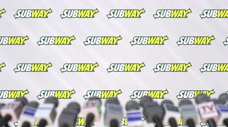 press wall : Press conference of SUBWAY, press wall with logo and microphones, conceptual editorial animation Stock Footage