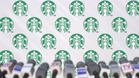 microphone : STARBUCKS company press conference, press wall with logo and mics, conceptual editorial animation Stock Footage