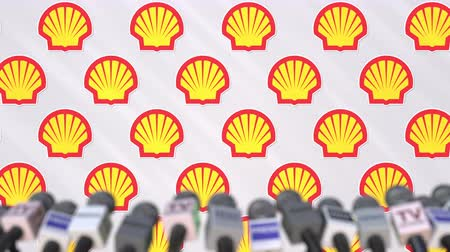 declaring : News conference of SHELL, press wall with logo as a background and mics, editorial animation