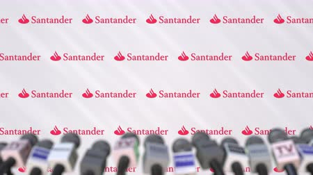 declaring : Media event of SANTANDER, press wall with logo and microphones, editorial animation Stock Footage