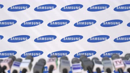 declaring : Media event of SAMSUNG, press wall with logo and microphones, editorial animation