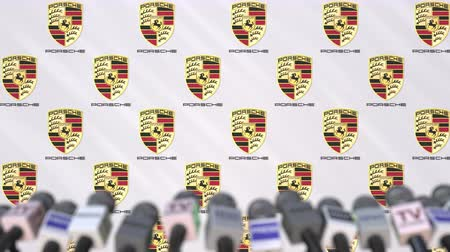 declaring : Media event of PORSCHE, press wall with logo and microphones, editorial animation