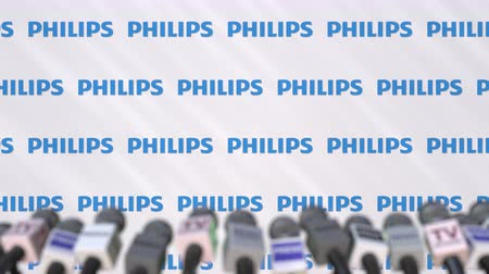 értesítés : Press conference of PHILIPS, press wall with logo and microphones, conceptual editorial animation