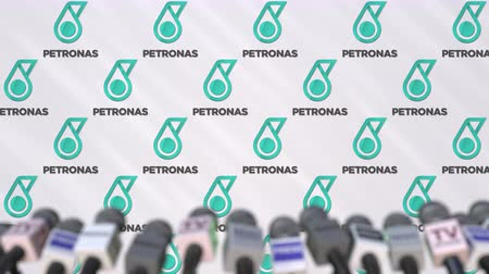 press wall : Media event of PETRONAS, press wall with logo and microphones, editorial animation