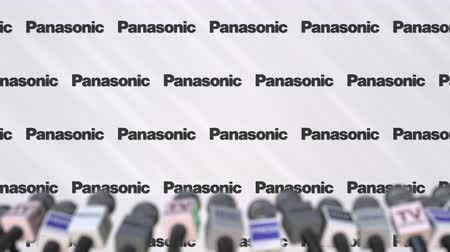press wall : Press conference of PANASONIC, press wall with logo and microphones, conceptual editorial animation