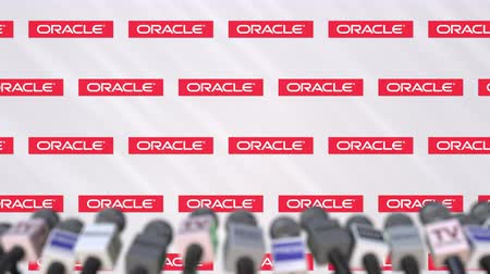 oficial : Media event of ORACLE, press wall with logo and microphones, editorial animation